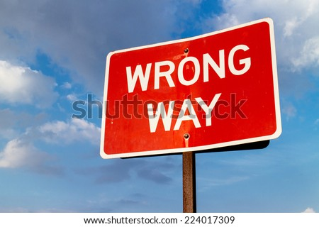A wrong way street sign. - stock photo