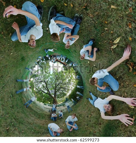 A 360x180 stereographic panorama with a young teenage man laying down on the grass in several different positions, with a tree inside of a circle. - stock photo