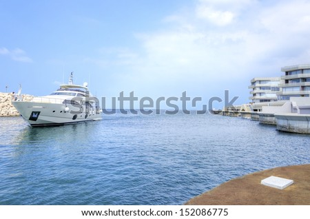A yacht and towers at the beautiful Marina in Zaitunay Bay in Beirut, Lebanon. A very modern, high end and newly developed area where yachts are embarked and it's perfect for a waterfront promenade. - stock photo