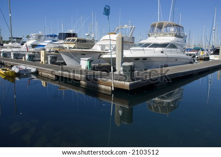a yacht harbor with sever yachts at dock - stock photo