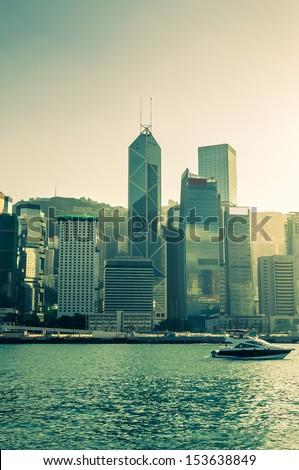 A yacht sailing along Victoria Harbor in Hong Kong. - stock photo