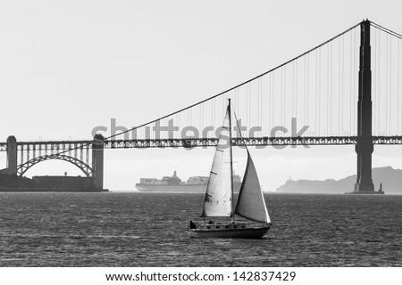 A yacht sails in San Francisco Bay near the Golden Gate Bridge in California, USA. - stock photo