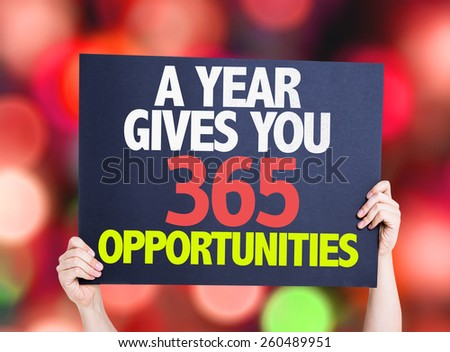 A Year Gives You 365 Opportunities card with colorful background with defocused lights - stock photo