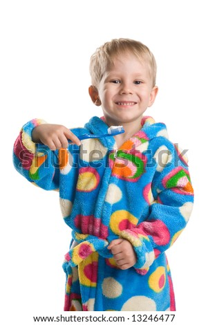 A 3 year old boy brushuing theeth on white - stock photo