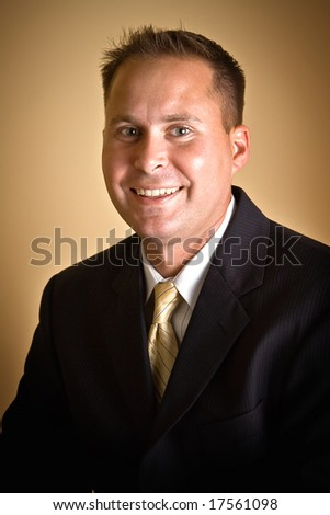 A 30-year-old male executive in suit and tie - head shot portrait.