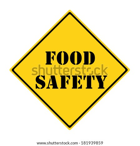 A yellow and black diamond shaped road sign with the words FOOD SAFETY making a great concept. - stock photo
