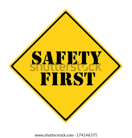 A yellow and black diamond shaped road sign with the words SAFETY FIRST making a great concept.