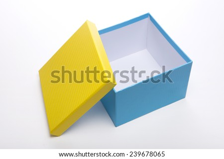 A yellow and blue(emerald green) opened empty(blank) gift box isolated white at the studio.  - stock photo