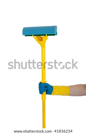 A yellow and blue rubber gloved hand holding a yellow and blue sponge mop on a white background - stock photo
