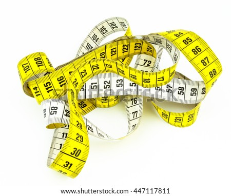 A yellow and white tape measure in a messy position, on a white surface