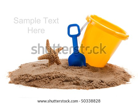 A Yellow Bucket and blue shovel on the beach with a starfish - stock photo