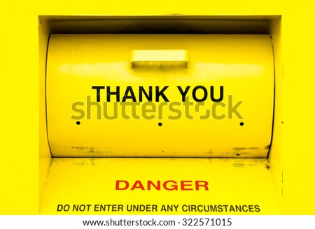 A yellow collection bin for donating clothes to charity - stock photo