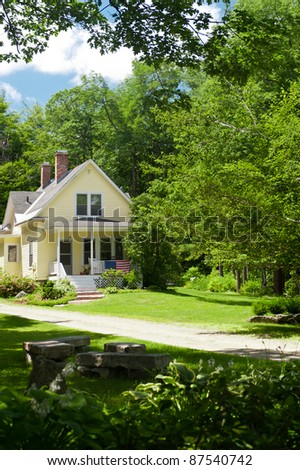 A yellow country home in New Hampshire - stock photo