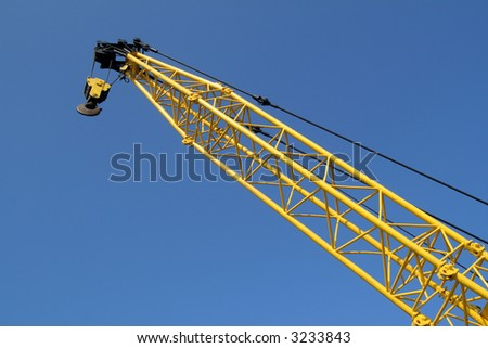 A yellow crane and a blue sky.