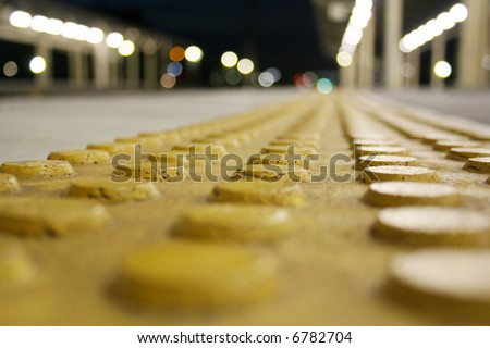 a yellow dot surface for blind persons - stock photo