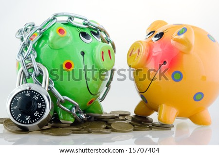 A yellow piggy bank and a locked green piggy bank with coins.