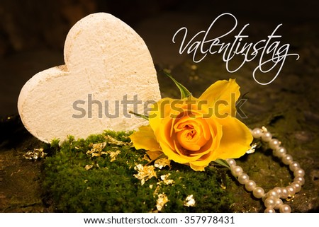 A yellow rose and a pearl necklace, entitled Valentine's Day (Translation: Valentine`s Day) - stock photo