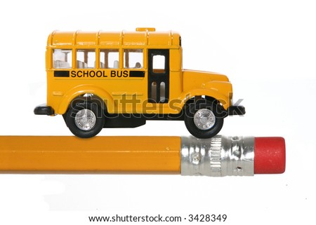 A yellow school bus on a pencil representing an education theme - stock photo