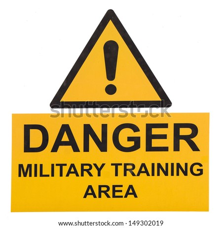 A yellow sign warning of a military training area - stock photo