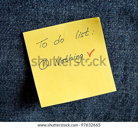 A yellow sticky note on a blue background - stock photo