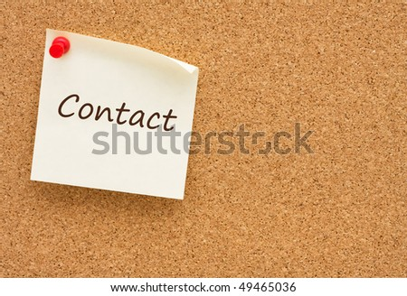 A yellow sticky note on a corkboard, Contact Us