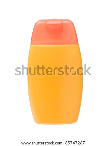 A yellow sunblock bottle with blank label - stock photo
