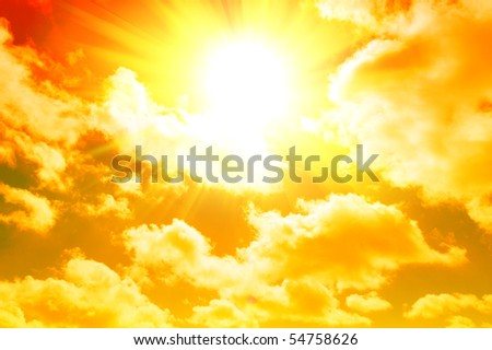 A yellow sunrise in a cloudy sky - stock photo