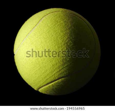 a yellow tennis ball in black back