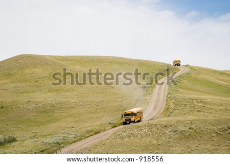 A yellow tour bus at the Cypress Hills Provincial Park, Saskatchewan, Canada - stock photo