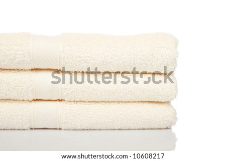 A yellow towels stacked reflected on white background