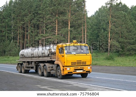 A yellow trailer truck - stock photo