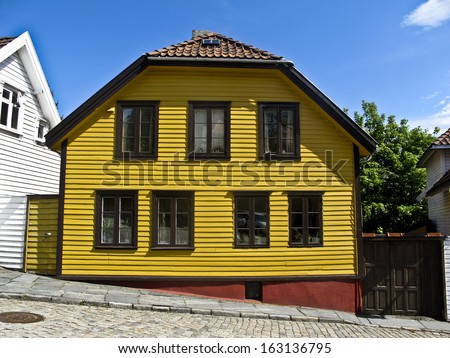 A yellow wooden house in Norway - stock photo