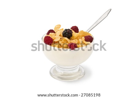 A yogurt, corn flakes and raspberries glass isolated on white background. It has a clipping path. - stock photo