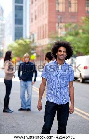 A young adult in a city setting with friends - stock photo