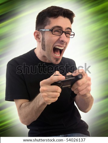 A young adult male on a funky green background getting pretty excited and upset about his video games. - stock photo