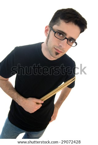 A young adult male with drum sticks - stock photo