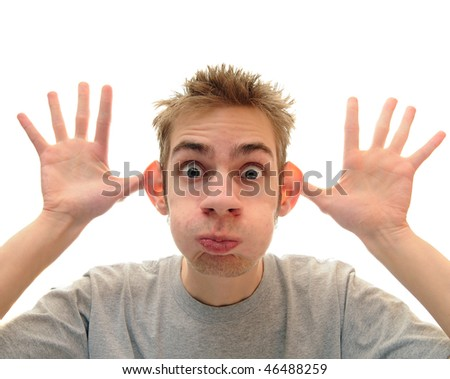A young adult man makes a silly monkey face over a pure white background - stock photo