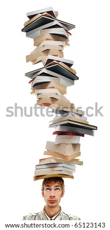 A young adult teenage man with stacks of books on top of his head. Isolated on white background.