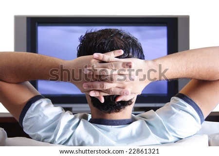 A young adult watching TV. - stock photo