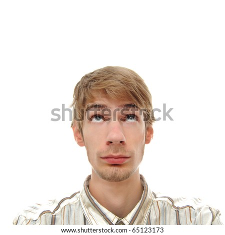 A young adult white Caucasian teenage man looking directly above. Professionally retouched. - stock photo