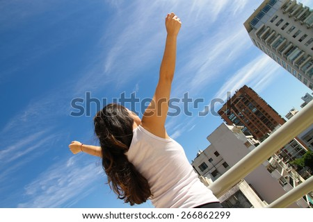 A young adult woman practicing Yoga in an urban environment. - stock photo