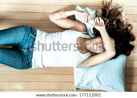 A young adult Woman relaxing at home. - stock photo