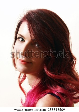A young adult woman showcases her new modern ombre hairstyle done professionally at the salon. - stock photo