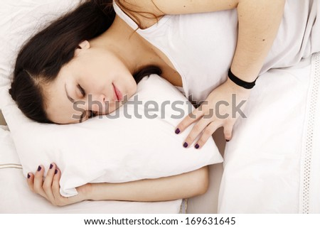 A young adult Woman sleeping on the Bed.