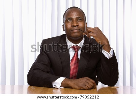 A young african american businessman in the office - stock photo