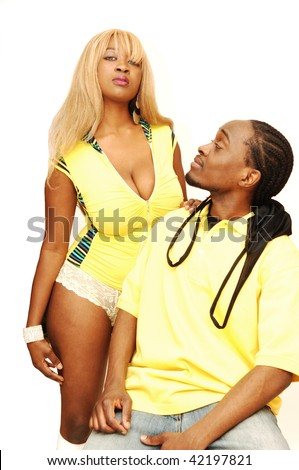 A young African American couple, he is sitting on a bar chair and she  standing behind him in the studio for white background. - stock photo
