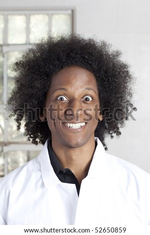 A young african american man with an afro making facial expressions while wearing a lab coat. Vertical shot. - stock photo