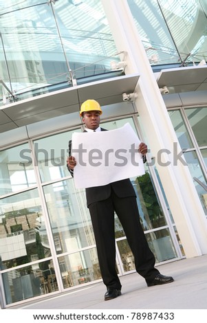 A young african american man working as an architect on a building site