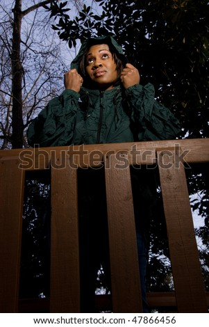 A young African American woman in a raincoat - stock photo