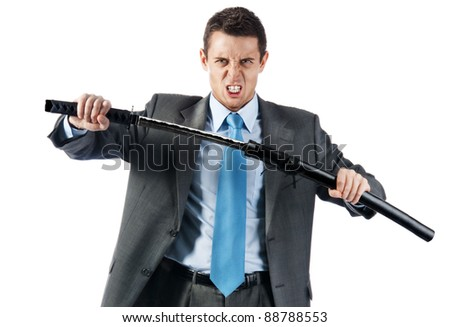 a young aggressive businessman with japanese sword